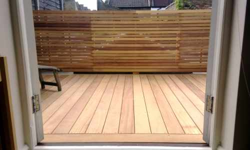 Decking with matching slatted panels