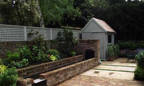 Traditional garden shed with cedar shingle roof