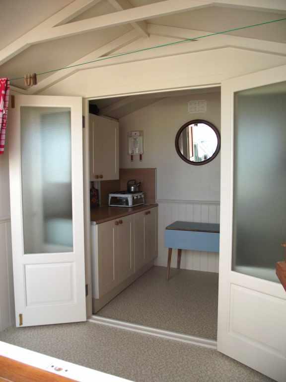 Summerhouses gazebos beach huts essex uk the garden for Beach hut interiors