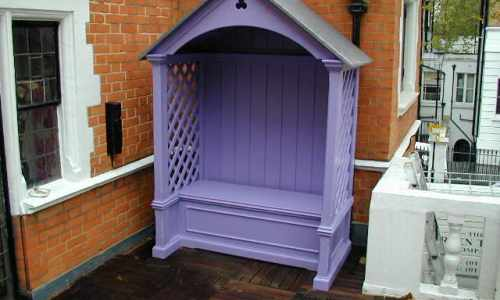 Painted seating arbour with storage