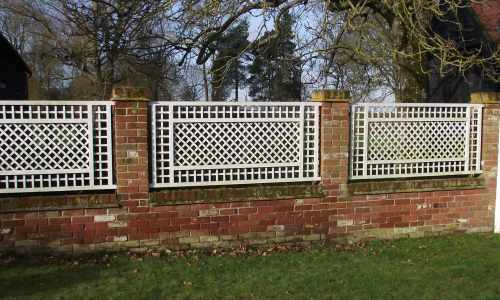 Decorative trellis between brick pilars