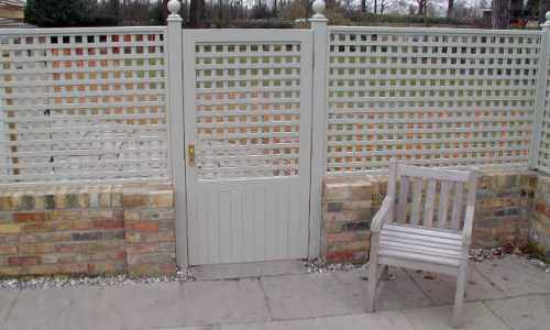 Painted trellis with matching finials & gate
