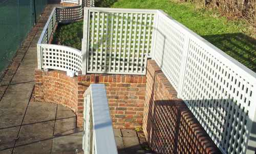 Shaped trellis to follow a brick wall