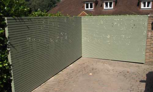 Painted slatted panels  to car parking area