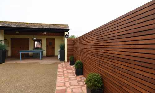 Iroko Stained Slatted Panels