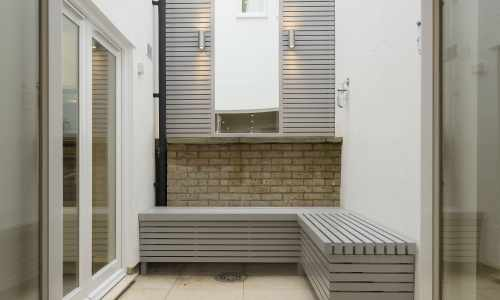 Painted Slatted Panels with Matching Slatted Bench