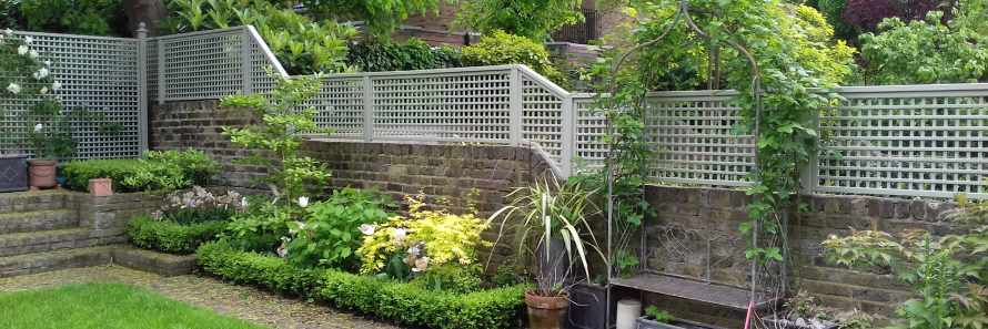 Painted Square Trellis Panels fitted atop a wall using Studded Fence Posts