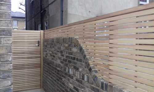 iroko Slatted 45/10 panels with matching gate