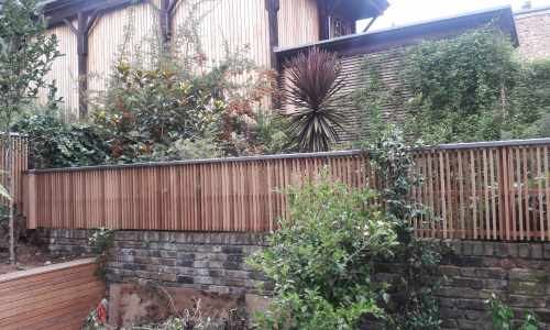 Vertical Cedar slatted panels with Lead capping