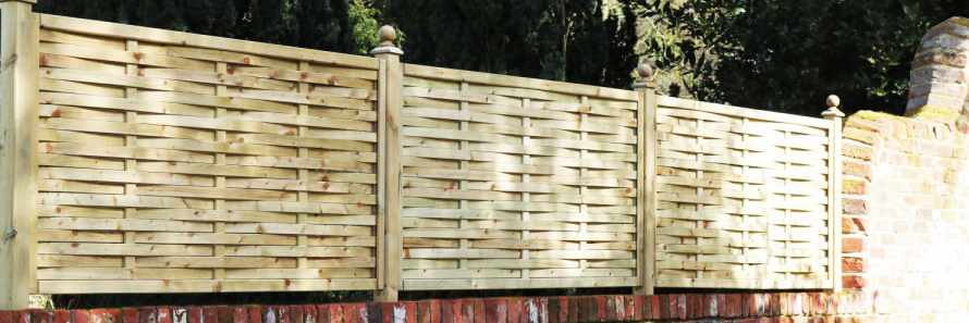 Weave Panels in natural Softwood installed atop a wall using Studded Fence Posts