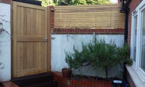 Tongue and groove gate with slatted panels