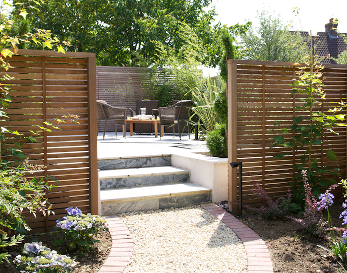 Create a secluded dining area with slatted panels