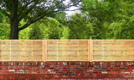 Contemporary Framed Slatted Panels installed atop a wall using Studded Fence Posts